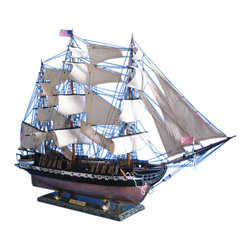 Handcrafted Nautical Decor - USS Constitution Limited 50'' - Large Model Ship - Large Scale Model Ship - Woo - SOLD FULLY ASSEMBLED--Ready for Immediate Display - Not a Model Ship kit--The indomitable flagship of the USS Constitution fleet, this Limited Edition scale replica tall model ship truly captures the pride and magnificence of �Old Ironsides�.�With the finest of craftsmanship, devoted attention to historical accuracy and brimming with museum-quality features and details, these tall ship models of the USS Constitution evokes the indomitable spirit of her namesake.�Displayed as the commanding centerpiece of any office, den or boardroom, Old Ironsides will inspire awe with her exquisite design and a victorious determination with her historic patriotism.--50'' Long x 15'' Wide x 34'' High (1:49 scale)----    Largest scale      replica tall ship models allow maximum detailing of features, additional deck      items, highly complex rigging, increased scale accuracy and other quality      enhancements--    Built from      scratch over      hundreds of hours by master artisans--    High quality      woods include      cherry, birch, maple and rosewood--    Individual wooden planks used in hull construction--    Meticulous      painting      accurately matches the real USS      Constitution --    Museum Quality features not available in other tall ship models under $5,000 or      any kit--    --        Accurate beakhead design and       scrollwork--        Netting on bow and along       gunwale to prevent boarding--        Handcrafted rosewood eagle on       the stern--        Increased detail of deck       features, cannon carriages, painting and other features--    --    --    Most complex      rigging of any      model with hundreds of blocks and deadeyes--    Four anchors weigh aside the bow--    Cannon carriages      tied-down to      deck to reduce recoil--    Amazing Details, including:--    --        23 masterfully stitched, heavy       canvas sails hold shap