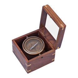 Handcrafted Nautical Decor - Antique Brass Lifeboat Compass w/ Rosewood Box 5'' - The Hampton Nautical Antique Brass Lifeboat Compass w/ Rosewood Box 5'' is a handsome reproduction of an antique brass gimbaled compass in a beautiful brass-inlaid hardwood box. The 2 3/4-inch (7 cm) diameter compass is fully gimbaled with a solid brass gimbal set. The lid of the hardwood case is inset with beveled glass so the compass can be viewed and used with the box closed, making this a beautiful addition to a nautical collection or executive's desk. The gimbaled compass is also protected by a second glass cover. ----The case is made from high-quality, smooth-finish, solid rosewood.--Custom Engraving is available on this item with a minimum quantity purchased. Contact us for details.-- ----    Antique brass housing for compass--    --    Remains level with double-gimbaled design      for accurate readings--    Glass-topped case for reading the compass even when the      case is closed--    Custom engraving/ photo etching available. Logos, pictures, and slogans can easily be put on any item. Typical custom order minimum is 100+ pieces. Minimum lead time to produce and engrave is 4+ weeks ----