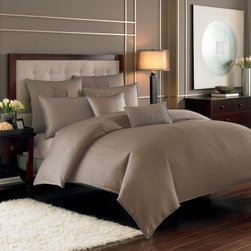 Nicole Miller Currents Duvet Cover - Nicole Miller Currents Duvet program is available in several colors. The textured jacquard offers designer details in this beautiful ensemble. Duvet cover has button closeures made of polyester jacquard.