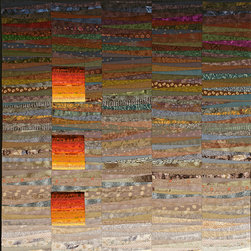 """More quilts - Against the greyed and mysterious colors of the background the three blocks of light float and tell a story even if you may not know the words of the story. The background of the quilt is composed of an incredible variety of muted colors to get just the right overall feeling. The orange blocks of light are pieced with very thin strips of cotton that add further texture and interest to this quilt. Of course it can be ordered in different colors and shapes. 45x45"""" Photo by John Polak"""