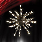 """Frontgate - 3D Starburst - 12"""" - Outdoor Christmas Decorations - Commercial-grade lights. 12"""" Starburst has 50 incandescent lights. 18"""" and 24"""" Starbursts have 100 incandescent lights. 120V. UL listed. A radiant accent to light up the night, our 3D LED Starburst shines bright on its own, but also looks great with other outdoor lighting. The versatile design allows you to decorate shrubs, trees and yards.  .  .  .  .  . Lead cord measures 10'L . Includes S hook and Y stake ."""