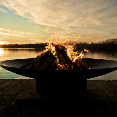 """Fire Pits - Great for Fall and Winter - The Asia fire pit series is a low, close to the earth Asian-inspired design. These durable fire pits feature a full-view of the entire fire from any seating height or angle. Dramatic and modern with a touch of Asia, these classic and timeless designs will enhance any outdoor room.  These original design fire pits, made-to-order in the U.S.A., are constructed from heavy duty 1/4"""" thick carbon steel and are the most durable steel fire pit made anywhere. The inner bowl has a high temperature resistant coating and comes with a 1 1/2"""" diameter rain drain. The outer iron oxide patina is maintenance free and the fire pit can be left outside in all weather conditions. Over time and use, the patina will mature and darken a few shades and then remain permanent forever. Each unique fire pit is individually numbered by the artist."""