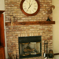 Fireplace Mantels - Adding to the rustic ambiance of the space was easy with a artificial woodland fireplace mantel which looks like real wood but is far lighter and easy to install.