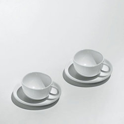 """Alessi Coffee and Tea - Alessi Coffee and Tea Fruit Basket Mocha Cup Set - Set of two coffee cups in bone china, with saucers. A distillation of the design achievement of 2003's """"Tea & Coffee Towers"""" project, these cups make the results accessible to the wider coffee-drinking public. The designers of each Alessi limited edition coffee & tea service have been asked to design a simple coffee cup, one that would exhibit the essence of the project. Manufactured by Alessi.Designed in 2007."""