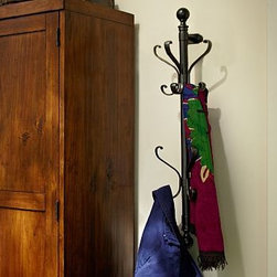 """Wall-Mount Coat Rack, Antique Bronze finish - Based on an antique coat tree we saw in a Paris bistro, our wall-mounted rack holds an impressive number of coats, hats and scarves without taking up an inch of floor space. 7.5"""" wide x 6"""" deep x 28.5"""" high Made of steel and zinc alloy with a nickel finish. Catalog / Internet only."""