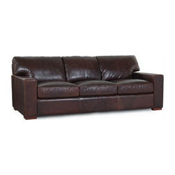 Moroni - Moroni - Grandeur Classic Leather Sofa in Coach Classic Brown - 660 - Imagine the sofa in a palace and you might just get the Grandeur. Its stately presence oozes a grand, regal feel – until you realize that it might just be the most comfortable sofa you ever sat in. Thanks to a drop-in coil system and channeled seat/back cushions filled with down and feather, the Grandeur sofa elevates the experience of any home while always inviting a second look.