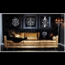 Inventory - Calling all rocker personalities and glamor queens - this couch is perfect for you! Covered in a devilishly fabulous, gold, croc patterned upholstery, it is absolutely gorgeous and a bold statement piece in any living room. A black vinyl trim contrasts brilliantly with the fabulous gold, making this couch the perfect mixture of edginess and glamor. GOLD OS 108 IN W 35 IN D 27 IN H