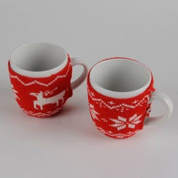 Christmas Sweater Knit Mugs - These festive sweater covers for your mugs will help keep your beverage warm. Plus, they are so cute!