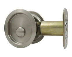 "Stone Harbor Hardware - Round Pocket Door Lock (privacy), Satin Nickel, 2-3/4"" Backset - The round privacy pocket door lock is available in satin nickel and vintage bronze. The latch face opens with the push of a finger and acts as a pull to open the door. The large, easy-to –use thumb turn makes locking and unlocking the door a breeze. Fits 1-3/8"" to 1-3/4"" thick doors and is available with either a 2-3/8"" backset or a 2-3/4"" backset. The lock fits a standard 2-1/8"" door prep for easy installation."