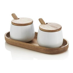 Condiment Duo Set - Ana-Reza Hadden's pairs porcelain and wood in a clean, warm design for condiment storage and serving. Oval wood tray corrals two white bowls, topped with slim wooden round tops with cutouts for their adorable, round-bowled spoons.