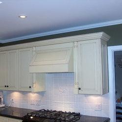 Antiqued White Cabinets & Range Hood - Raised panel cabinet doors and custom made range hood ...
