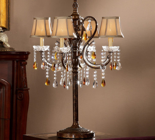 Tribecca Home - TRIBECCA HOME Clarissa Tea Crystal Table Lamp - Accentuate your living space with this stunning crystal table lamp. The eight-light lamp features a candleabra design with an antique bronze finish,mini-bell shades that add an elegant touch,and dangling strands of crystals that reflect the light.