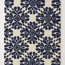 Coqo Floral Rug, Navy - This rug has the classic look of blue and white but with a twist.