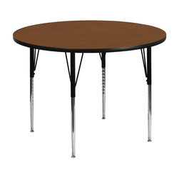 Flash Furniture - Flash Furniture 42 Inch Round Activity Table with 1.25 Inch Laminate Top - Flash Furniture's XU-A42-RND-OAK-H-A-GG warp resistant high pressure laminate Round activity table features a 1.25'' top and a high pressure laminate work surface. This Round high Pressure Laminate activity table provides an extremely durable (no mar, no burn, no stain) work surface that is versatile enough for everything from computers to projects or group lessons. Sturdy steel Legs adjust from 21.25'' - 30.25'' high and have a brilliant chrome finish. The 1.25'' thick particle board top also incorporates a protective underside backing sheet to prevent moisture absorption and warping. T-mold edge banding provides a durable and attractive edging enhancement that is certain to withstand the rigors of any classroom environment. Glides prevent wobbling and will keep your work surface level. This model is featured in a beautiful Oak finish that will enhance the beauty of any school setting. [XU-A42-RND-OAK-H-A-GG]