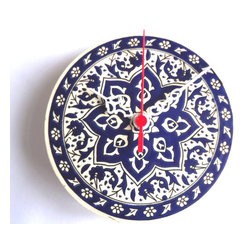 ecofirstart - Ceramic Turkish Tile Wall Clock - This decorative timepiece will add a bit of Turkish flair to your kitchen. It features a traditional flowery design and vibrant blue and white colors. It'll make telling time a little more fun.