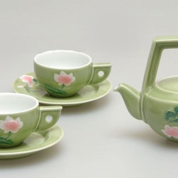 Garden Party - The Tea Set - this tea set features truly unique structure without being off-putting. truly special with their atypical and stunning handles and beautifully contrasting colors, this set will leave your guests thinking of you and this classy set for days!