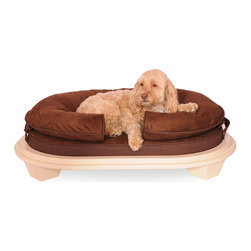 Frontgate - Katherine Elizabeth Cody Dog Bed Dog Bed - Our human quality bolster and cushion offer an exceptional sleeping experience for dogs who prefer to sleep with their heads supported and elevated. Cocoa cushion is suede with faux leather welting; Greystone and Seaglass cushions are 100% cotton on top with a faux leather bottom. Bolster and cushion filled with visco elastic memory foam, which conforms to the pet's body, reducing pressure points and providing ultimate comfort. Wood base painted in water-based non-toxic paint, with a variety of colors. Bolster and cushion flip for comfort. Wrap your pet in comfort with the modern and stylish Katherine Elizabeth Cody Dog Bed. Veternarian researched and approved, this bolster bed with cushion offers an exceptional sleeping experience for dogs who prefer to sleep with their heads supported and elevated. A practical ottoman frame holds the bed off the floor and away from bothersome condensation, insects, heat, and cold, for the ultimate in relaxation. Created by an interior designer, the ottoman frame will be a beautiful accent to your home decor.. . . . . Pillow-top cushion for plushness. To clean, remove cushion and bolster cases; machine wash cases in cold, gentle cycle; tumble dry low; dust ottoman frame. Patented design, veterinarian researched, tested and approved. View size chart and care instructions . Made in USA.