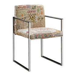Julie Armchair - I love the rectilinear lines of this chair, which add polish, combine with exuberant upholstery.