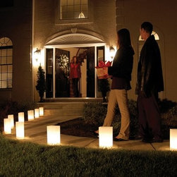 Lumabase Electric White Luminaria Kit - Set of 10 - The Lumabase Electric White Luminaria Kit - Set of 10 are a fun way to greet your guests with a warm welcome.Complete kit includes: 10 weather-resistant fold-up plastic lanterns, 10 anchor stakes, one 30-ft. UL-listed electric cord with end-to-end connectors, 10 clear C7 5-Watt bulbs.About JH SpecialtiesFounded in 1989, JH Specialties originated when the company's entrepreneurs sought to redesign a bulky and messy celebration staple. Today, JH Specialties offers unique decorative Luminarias and accessories for special and seasonal occasions to event planners, neighborhoods, fundraising organizations, and retail stores. Since special occasions shouldn't be hard to plan, JH Specialties offer top-of-the-line products for unique events at a competitive price and a great value. The title of Leader in Luminarias comes from their commitment to quality and customer service.