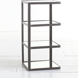 A Table For Contents - This accent table is the ultimate in stacked storage. Four levels of shelf space provide just enough room to showcase collectibles, hold magazines and books, and keep necessities within reach. It's crafted from iron with a natural finish and light-reflecting, mirrored shelves. Wisteria