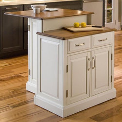 HomeStyles - 2-Tier Kitchen Island - Honey oak top. Two storage drawers. Two door storage cabinet with two adjustable shelves. Compact eating area with two hidden storage cabinets. Nickel hardware. Magnetic push latches. Provides the utmost functionality with its ample preparation space. Made from Asian hardwood. White finish. Made in Thailand. Preparation counter top height from the floor: 30.5 in. H. 30 in. L x 39.25 in. W x 36.5 in. H. Assembly InstructionsThe woodridge kitchen island provides a space-saving solution for the family on the go. This island provides the utmost functionality with it's ample preparation space.