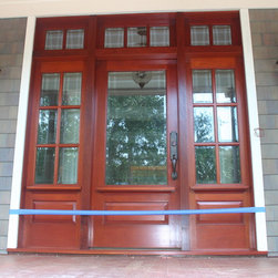 Front Doors - Custom mahogany wooden door for Kiawah, SC house includes door, jamb, two sidelights, and three section transom.  Photo and craftsmanship by Bill Hussey