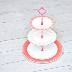 Vintage Cake Stand Rockabilly Pink Tulle China Stand - Pink Tulle is a stand inspired by rockabilly and ballet. Three tiers of mid century milk glass combine to create a no frills tribute to femininity--with all of the frills! Yup, women are complicated and the worn, patinated beauty of this flirty stand is emblematic of that. A bottom tier of rustic flamingo pink rimmed American milk glass creates a solid base while the upper tiers flutter and undulate in swirls of white and pink.