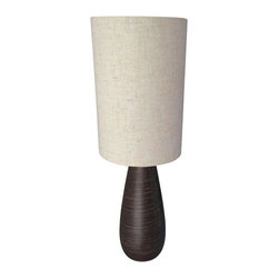 Small Modern Ceramic Table Lamp - This petite modern ceramic lamp is perfect for a small desk space or bathroom area. It's natural linen shade and organic form are an attractive pairing!