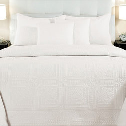 None - Cathedral Whisper White 3-piece Quilt Set - Turn your bedroom into a luxurious, stylish haven with this elegant white quilt set made from 100 percent cotton. Featuring a softly-textured pattern, this classic and simple quilt works well with most decorating styles and color schemes.