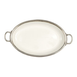 Tuscan Large Oval Tray - Poetically styled with a sparing simplicity of detail, the Tuscan Collection Oval Platter is a serving piece made from durable, versatile white ceramic edged with the unmistakable old-world class of genuine Italian pewter.  The metal curves to form rounded carrying handles at the short end of the oval, making this smooth and refined tray perfect for carrying roasts or offering appetizers.  This useful addition to your serving pieces coordinates smoothly with your existing ware.