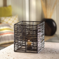 Malibu Creations - Malibu Creations Small Thatched Candle Stand - Woven wires wrap around a simple framework to create this striking-but-small Thatched Candle Stand. The black iron construction holds a tealight candle cup at bottom center, awaiting the candle of your choice. Light the wick inside and you'll get a fantastic display of light and shadow that will turn your tabletop into a modern masterpiece.