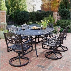 Home Styles Biscayne Black Swivel Patio Dining Set - Seats 6 - Exuding oodles of upscale appeal, the Home Styles Biscayne Black Swivel Patio Dining Set - Seats 6 makes its presence felt in any setting with its perfect mix of traditional style and practical function. A stylish, yet functional addition to your patio or sunroom, this set, which includes a 72-inch oval dining table and six swivel dining chairs, is as fetching as it is functional. With an attractively patterned tabletop that allows water to pass through freely, the table is large enough for six place settings and has an umbrella hole that will support a standard patio umbrella for some much-needed shade on hot days. The stylish, scroll-accented swivel chairs are not only comfortable, they will also have you lingering at the table longer than usual with their soothing rocking motion.Constructed of sturdy cast aluminum, each piece sports a powder-coat antiqued Black finish sealed with a clear coat to keep it looking like new for years to come. A cost-effective alternative to cast iron, this outdoor dining set gives you the beauty of ornately designed pieces without the high cost. Adjustable nylon glides prevent damage to your floor and provide stability on uneven surfaces.Dimensions:Table dimensions: 42W x 72D x 28.5H inchesSwivel chair dimensions: 24.4W x 22.05D x 33.46H inchesSeat height: 16 inchesAbout Home StylesHome Styles is a manufacturer and distributor of RTA (ready to assemble) furniture perfectly suited to today's lifestyles. Blending attractive design with modern functionality, their furniture collections span many styles from timeless traditional to cutting-edge contemporary. The great difference between Home Styles and many other RTA furniture manufacturers is that Home Styles pieces feature hardwood construction and quality hardware that stand up to years of use. When shopping for convenient, durable items for the home, look to Home Styles. You'll appreciate the value.
