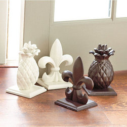 Ballard Designs - Cast Iron Doorstop - Hand finished. Multi-purpose. Our Cast Iron Doorstop is weighty enough to hold a heavy door or a shelf of books without tipping. A protective felt bottom protects surfaces from scratches, so you can use it anywhere. Choose our signature Fleur de Lis or Pineapple in Cream or Rust. Cast Iron Doorstop features:  . .