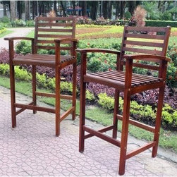 Palmdale Acacia Patio Bar Stool - Set of 2 - Crafted of luxurious solid acacia wood, the Palmdale Acacia Patio Bar Stool - Set of 2 can be placed indoors or out for bar-height relaxation and dining. These are standard sized bar stools with ladderback styling and broad arms for comfort. The design includes footrests. Some easy assembly required.About International Caravan, Inc.For nearly half a century, International Caravan, Inc. has been scouring the world for unique furniture and home decor products to bring to the international market. Today, International Caravan, Inc. is ranked as one of the leading import and wholesale distributors in the nation. Their products can be found on the largest E-commerce websites as well as in America's leading retail stores.