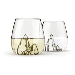 ARULIDEN - Escape, Hand Blown Glass Tumblers by Aruliden - Set of 4 - Escape into the stunning landscapes that wrap themselves around a choice beverage. The stemless glassware frees itself from extra garnish, as the hand blown peeks and dips captivate us so. Might I persuade you to take a long weekend, somewhere beautiful. Where the view takes your mind off everything that usually controls it. Have a few drinks, laugh harder than you have in along time, and just escape. You deserve it. Designed in lieu of the larger original Glasscapes by Aruliden.