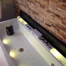 Contemporary Bathtubs by Plumbed Elegance