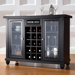 Crosley - Cambridge Sliding Top Bar Cabinet in Black - Elegantly entertain guests with this sliding top bar cabinet constructed of solid hardwood and wood veneers. The beautiful beveled/tempered glass doors and raised panel drawer front are classically styled to enhance any home decor. The sliding top expands to greatly increase the size of your serving area. Behind the two doors, you will find adjustable shelves and plentiful storage space for spirits, appliances and other items that require additional space. The center storage area is great for up to 15 bottles of wine, or if you prefer, remove the wine storage cubes to reveal an adjustable shelf. Style, function, and quality make this sliding top bar cabinet a wise addition to your home. Features: -Cambridge collection. -Hardware finish: Brushed nickel. -Hand rubbed and multi step finish. -Solid hardwood and veneer construction. -Sliding expandable top. -Beveled and tempered glass doors. -Adjustable levelers in legs. -Doubles as a serving station when entertaining. -Plenty of room for storing barware and spirits. -Assembly required.