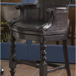 """Tommy Bahama Home - Kingstown Dunkirk Swivel Counter Stool in Tamarind - The perfect seat for enjoying a cup of plantation punch, the Kingstown Dunkirk Counter Stool in Tamarind adds a dash of adventure to a comfortable design, including an open-cane back and a swivel seat covered in antiqued leather. It displays a timeworn look that guarantees a distinctive design with a sense of a well-traveled life. Features: -Distressed Tamarind finish. -Constructed of mahonie solids, American maple and mahonie veneers, woven cane, and hand-tooled leather. -Custom-designed, solid brass hardware, with substantial heft to the hand, and finished in an aged bronze with copper undertone. -Open-cane back. -Swivel seat covered in antiqued leather. -Overall Dimensions: 41.5"""" H x 24.75"""" W x 23.75"""" D. Whats in a Name? The evocative pieces in Kingstown give you the sense of a well-traveled, of items hand-selected during journeys around the globe, from the West Indies to Africa to the Caribbean. While retaining the laid back appeal of the Tommy Bahama brand, Kingstown broadens the approach with a relaxed traditional look that can fit into many lifestyles. Let your home be touched by this collection that has British Colonial look with a hint of Campaign and a whisper of Safari."""