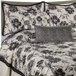 Nicole Miller - Nicole Miller Onyx Floral Coverlet - The Onyx Floral coverlet brings a modern twist to natural bedding with a dramatic black and ivory floral design that blossoms on a luxurious satin and quilted base. It's the perfect way to update your bedroom in classic, yet contemporary sophistication.