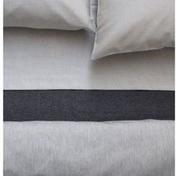 """Area - JEWEL Bedding Collection by Area - The Area JEWEL Bedding Collection is a precious addition to the modern bedroom. The softness of the heather grey color is indicative of the collection's literal softness. Each sheet, pillowcase and duvet cover in the JEWEL collection is made out of a smooth and subtly shiny 100% reversible cotton sateen. Founded in 1990 by Swedish fashion designer Anki Spets, Area creates fine modern bedding based on the Scandinavian design tradition of """"good design for everyday."""" Based in New York City, Area sets itself apart by designing and producing long-lasting textiles with lovely original patterns, carefully chosen colors and subtle detailing. On top of that, Area sheets, blankets and duvet covers are made using only the finest organic cotton, linen and baby alpaca wool."""