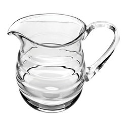 Portmeirion - Sophie Conran Glass Medium Jug with Handle Multicolor - 422551 - Shop for Beverage Dispensers and Servers from Hayneedle.com! Just picture the Sophie Conran Glass Medium Jug with Handle brimming with fresh squeezed orange juice or sun-brewed iced tea. This gorgeous pitcher is crafted of durable glass and while it can be cleaned in the dishwasher on a low heat setting we recommend you hand wash after each use.About PortmeirionStrikingly beautiful eminently practical refreshingly affordable. These are the enduring values bequeathed to Portmeirion by its legendary co-founder and designer Susan Williams-Ellis. Her father architect Sir Clough Williams-Ellis was the designer of Portmeirion the North Wales village whose fanciful architecture has drawn tourists and artists from around the world (including the creators of the classic 1960s TV show The Prisoner). Inspired by her fine arts training and creation of ceramic gifts for the village's gift shop Susan Williams-Ellis (along with her husband Euan Cooper-Willis) founded Portmeirion Pottery in 1960. After 50+ years of innovation the Portmeirion Group is not only an icon of British design but also a testament to the extraordinarily creative life of Susan Williams-Ellis.The style of Portmeirion dinnerware and serveware is marked by a passion for both pottery manufacturing and trend-setting design. Beautiful tactile nature-inspired patterns are a defining quality of Portmeirion housewares from its world-renowned botanical designs modeled on antiquarian books to the breezy natural colors of its porcelain and earthenware. Today the Portmeirion Group's design legacy continues to evolve through iconic brands such as Spode the Pomona Classics collection and the award-winning collaboration of Sophie Conran for Portmeirion. Sophie Conran for Portmeirion:Successful collaborations have provided design inspiration throughout Sophie Conran's life. Her father designer Sir Terence Conran and mother food writer Caroline Con