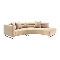 Calcutta Rounded Sofa - More than just a traditional sofa the sleek and long Lazar Calcutta Rounded Sofa has an asymmetrical design and crisp modern style. This long sofa is comprised of two pieces to create one large curving strip of seating. One side of the sofa features a comfortable arm while the other side features a bumper style back that creates an open but finished look. Chrome sled-style legs hint at a retro influence. The attached cushions are tightly covered and feature a distinctive horizontal crease that visually lengthens the sofa. The durable fabric is a soothing beige color with tiny white nubs for texture and depth. The basic tan color and sleek lines combine to create a timeless sofa that will complement any home style or decor.The sturdy kiln-dried hardwood frame with corner blocking has been double-doweled glued and stapled for incredibly durable support. The 2.0 density polyfoam seat core has been sandwiched between and book-wrapped with thick layers of Dacron providing an unrivalled combination of comfort support and resiliency. A fully wrapped outer skin prevents fiber migration and ridging while the webbing suspension system will never sag. Even the outside arm and back have been padded so you won't feel the wood frame. Quality craftsmanship like this ensures that your sofa will stay beautiful and comfortable for years to come.1-arm loveseat: 63W x 38D x 29H inchesArmless sofa with bumper: 91W x 38D x 29H inchesAbout Lazar IndustriesFounded in 1983 Lazar Industries is a privately held corporation specializing in high-quality custom-made upholstery. With a reliable workforce of highly skilled craftspeople Lazar has become one of the premier upholstered furniture resources in the industry. Lazar's fashionable and comfortable seating products are made in the USA in two manufacturing facilities one in southern California and one in North Carolina.