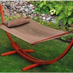 Algoma 12 ft. Wooden Arc Stand with Caribbean Hammock and Pillow - Comfort and style come together in the Algoma 12 ft. Wooden Arc Stand with Caribbean Hammock and Pillow. The Caribbean-style hammock is made of tightly-woven soft polyester rope and includes a matching pillow with tie-downs. A gorgeous Russian Pine wood arc stand stretches the hammock, and features an outdoor finish to resist rot, mold, and mildew. Beautiful hand-turned hardwood spreader bars, poly-rope clewed ends, and outdoor-plated hardware ensure years of enjoyment.About Algoma Net CompanyHaving been in business for over 100 years, Algoma is proud to present you with a selection of the finest designs in hammocks and other outdoor lifestyle products. The Algoma family of all-American crafted products is recognized for its quality, styling, and value. Their commitment is to continue providing you with the best relaxation products under the sun.