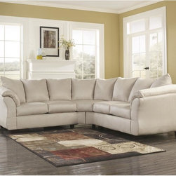 Signature by Ashley - Darcy Sectional in Stone Fabric - 2 Piece Sectional. Contemporary Design. Plush Upholstered Arms. Stone Fabric Upholstery. Pillow Back Cushions. Fixed Back. Loose Seat Cushions. CA117 Fire Retardant Foam. Black Bottom Dust Cover. Plastic Triblock Feet. Pieces attach with Connecting Brackets. Durable Frame Construction. Seat and Back Spring Rails cut from .875 in. Thick Hardwood. Corners are Glued, Blocked and Stapled. Upholstery pre-approved for wearability and durability against AHFA Standards. Cushion core constructed of low melt fiber wrapped over high quality foam. 100% Polyester. Spot clean with water based cleaner.