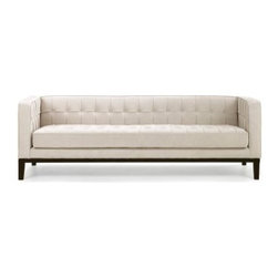 Armen Living Roxbury Cream Fabric Sofa - Low-backed and lovely - that's the Armen Living Roxbury Cream Fabric Sofa. With a super-low silhouette that's marvelously modern, this sofa is covered in textured chenille fabric in a dreamy-as-can-be cream color. The button-and-tuck detailing adds a little visual interest, while the wooden legs have a slightly tapered shape. Group it with other pieces in Armen Living's Ruxbury line, and you'll have a living room setting that can only be called the mod squad.Delivery Notice: About Armen LivingImagine furniture without limits - youthful, robust, refined, exuding self-expression at every angle. These are the tenets Armen Living's designers abide by when creating their modern furniture collections. Building on more than 30 years of industry experience, Armen Living combines functional versatility and expert craftsmanship into their dramatic furniture styles, all offered at price points fit for discriminating budgets. Product categories include bar stools, club chairs, dining tables, ottomans, sofas, and more. Armen Living is based in Sun Valley, Calif.