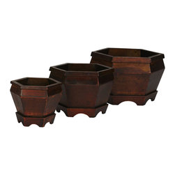 "Nearly Natural - Wooden Hexagon Decorative Planter (Set of 3) - Going with the philosophy of ""more is better"", our three-piece Hexagon Wood Pot set is sure to triple the pleasure. Each pot is finished with a beautiful earthen finish in a rich variation of dark and light shades. With the sharp hexagon shaped body and rim, this interesting collection is sure to catch many a passerby's eye, be it in your home or office. Colors: Burgundy. Height: 7.5 in; Width: 12 in; Depth: 12 in."