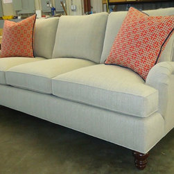 "Pieces constructed for Gretchen O. Studio of Columbia, SC - Gretchen selected our ""William"" sofa, 86"" long with three seats.  Her fabric is an elegant linen and she chose Dark Walnut for her wood finish.  The bright geometric print pillows we made for her give it a 'pop' of color."
