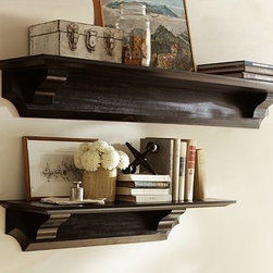 "Classic Wood Shelf, 5', Black - Architectural elements such as beveled edges, cut-out corners and curved supports give our wall shelving a classic profile. Use several in rows or staggered to showcase frames, books and accessories. 3' Shelf: 36"" wide x 10"" deep x 7.5"" high 5' Shelf: 60"" wide x 10"" deep x 7.5"" high Made of MDF with a black or white painted finish. Mounting hardware included."