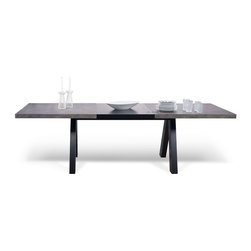 Temahome - Apex Extending Dining Table - The design of the extendable Apex dining table was reduced to its very essential elements. Its shape is inspired by the traditional trestle tables. Strong but lightweight, Alpha is also a winner in terms of functionality, as its structure reaches the table's top towards the center, allowing for a simple and comfortable interaction with the piece