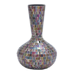 Metal and Glass Combination Vase with Multi Color - Embellish your living space with this stylishly designed metal glass vase. Reflecting a myriad of hues, this vase is comprised of multiple colors that are expertly pooled to radiate charm and rich ambience. The vase is perfectly suitable to be placed decoratively anywhere in your living space. This vase is made from a high quality combination of metal and glass, and is beautifully shaped like a classic jar. The small round base at the bottom curves nicely upwards into the broad spacious container part, and rises to stand tall at the mouth. With its compact design and smooth finish, this vase is visually appealing, and adds value to the space it occupies. Be it real flowers or artificial decorative pieces, you can suitably add them into this vase, and enhance the mood of the surroundings. With the rich array of colored glasses and attractive design, this vase is a worthy art piece to have in your home.. It comes with a dimension: